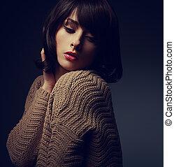 Beautiful woman with short hair in warm cardigan. Art closeup
