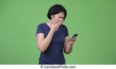 Beautiful woman with short hair using phone