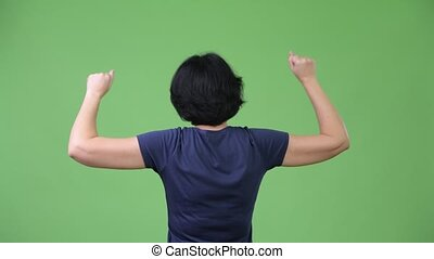 Beautiful woman with short hair with fists raised - Studio...