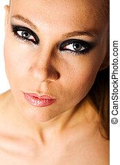 beautiful woman with smokey eyes makeup isolated