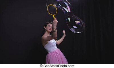 Beautiful woman with soap bubble