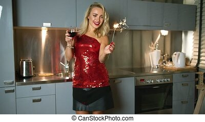 Beautiful woman with sparkler and wine