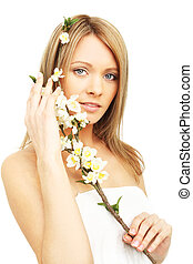 Beautiful woman with spring flowers isolated on white