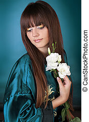Beautiful Woman with stright Long Hair and flowers in the hand