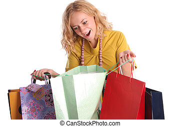 Beautiful woman with surprise looks in a bag