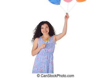 Beautiful Woman with sweet lollipop and baloons.