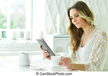 Beautiful woman with tablet in hands