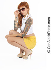 Beautiful woman with tattoos and sunglasses