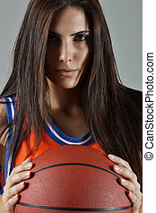 beautiful woman with the basketball