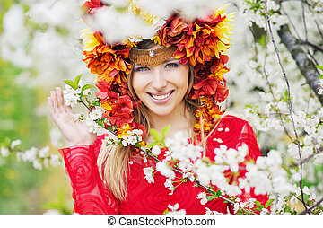 Beautiful woman with the colorful flowery hat