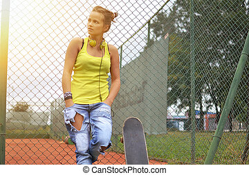 beautiful woman with the skateboard