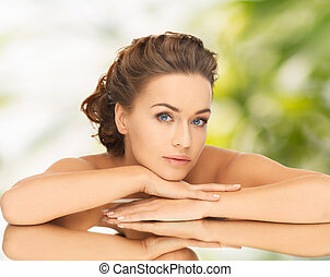 beautiful woman with updo and mirror - health and beauty...