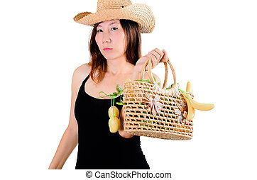 Beautiful woman with vegetables basket, isolated on white.
