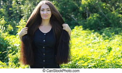 Beautiful woman with very long hair. Hairstyle.