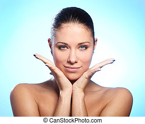 Beautiful woman with water drops on face