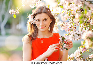 Beautiful woman with white flowering tree