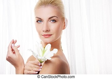 Beautiful woman with white lily