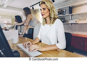 Beautiful woman working in a modern office