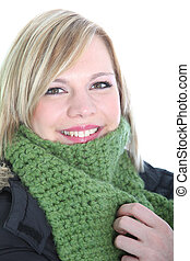 Beautiful woman wrapped in a winter scarf