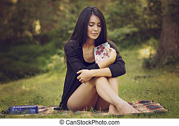 beautiful woman writer is inspired by nature