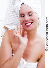 Beautiful woman's face with cream.