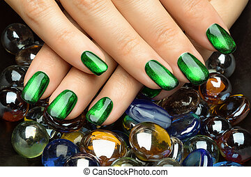 Beautiful woman's nails with nice stylish manicure.