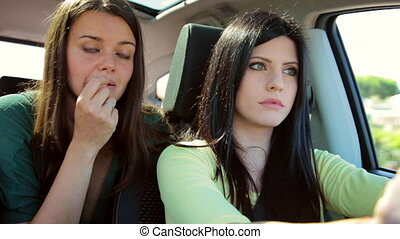 Beautiful women arguing in car while driving closeup -...