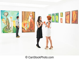 beautiful women at exhibition opening