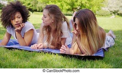 Beautiful women communicating on grass