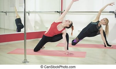Beautiful women doing gymnastics and doing stretching in the studio 4k