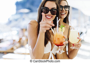 Beautiful women drinking cocktails