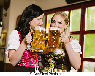 Beautiful women drinking Oktoberfest beer - Photo of two...
