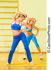 Beautiful women exercising in fitness club