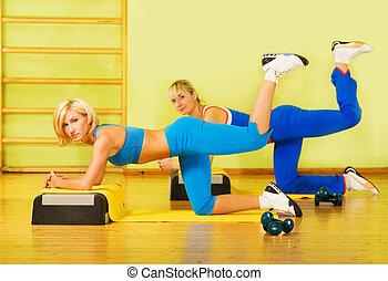 Beautiful women exercising in fitness club