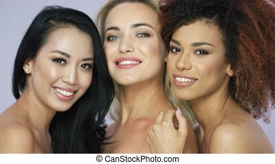 Beautiful women friends posing together - Portrait of three...