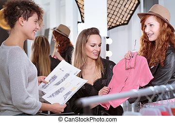 Beautiful women getting ready for photoshoot