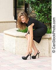 Beautiful women in a black dress.