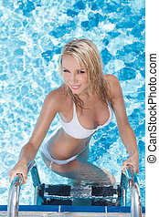 Beautiful women in pool. Top view of beautiful young women ...