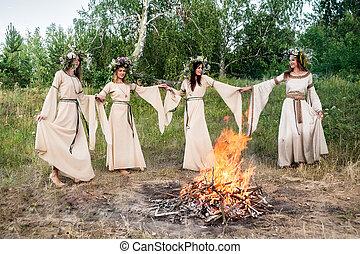 Beautiful women in traditional dresses