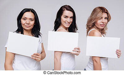 Beautiful women of different ethnicities demonstrating white signs