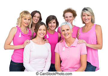 Beautiful women posing and wearing pink for breast cancer