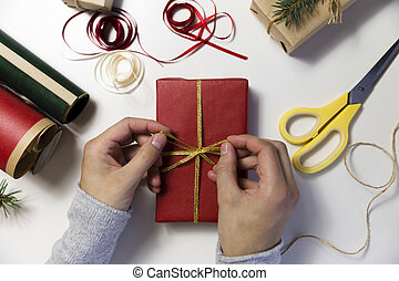 Beautiful women preparing christmas presents. Holiday and christmas concept. Wrapped christmas gifts.