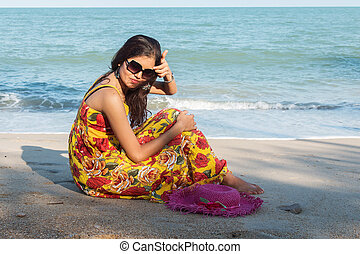 Beautiful women sitting on the beach