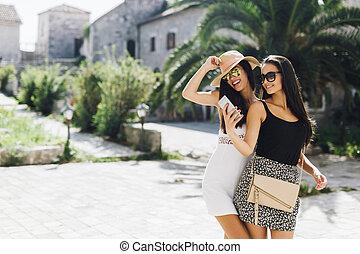 Beautiful women taking selfies in summer