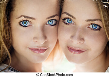 Beautiful women with blue eyes against the background of...
