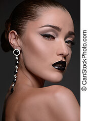 Beautiful women with earrings. Portrait of beautiful fashion model looking at camera
