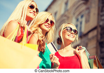 beautiful women with shopping bags in the ctiy - sale and ...