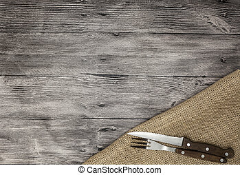 Beautiful wooden background with napkin knife and fork. Fine background for the menu of restaurants and cafes