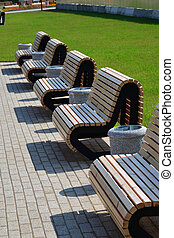 Beautiful wooden benches in a city park in Moscow, Russia