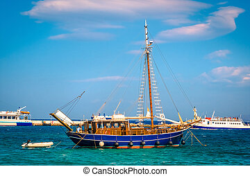 Beautiful wooden boat on water i